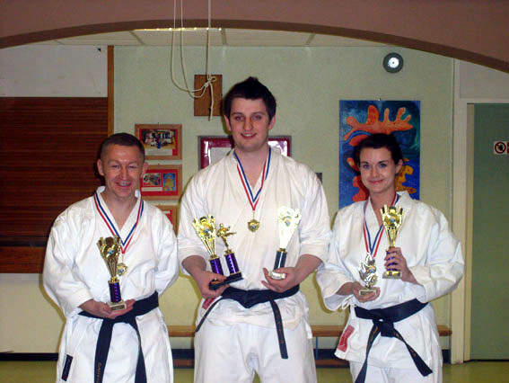 Left to Right, Instructor Gary, Jonothan and Instructor Louise with trophies. Jonothan 1st Senior Male Kumite, Louise 3rd Senior Womens Kumite and all with the  2nd in Senior Team Kumite